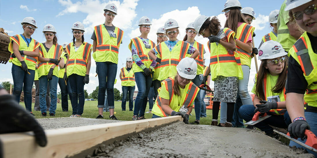 Girls learning about being women in construction at Miron Construction event