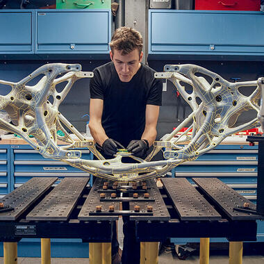 Man works on large aerospace part developed with generative design